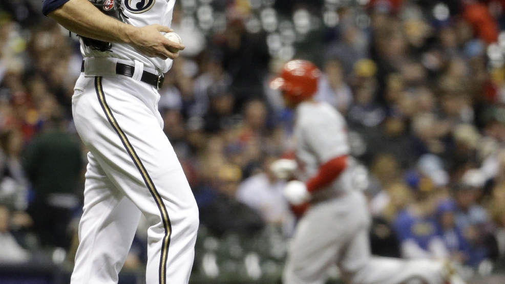 Milwaukee Brewers relief pitcher Jim Henderson looks down as St. Louis Cardinals' Matt Holliday rounds the bases after Holliday hit a home run during the ninth inning of a baseball game Tuesday, April 15, 2014, in Milwaukee. (AP Photo/Morry Gash)