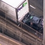 I-5 South closed on Marquam; Driver jumps out before car is crushed between semi and SUV