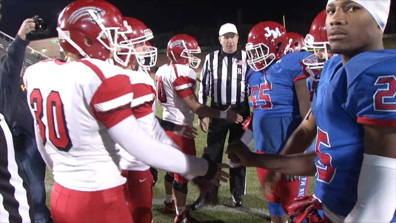 John Marshall and Stigler during the coin toss of the playoff game on Friday, Nov. 25, 2016 (Ivan Gibson / KOKH)