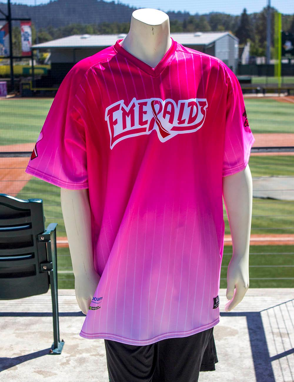 Eugene Emeralds graphic designer Danny Cowley created this neon jersey for Pink in the Park – a night dedicated to raising breast cancer awareness. The Eugene Emeralds will hold a Throwback Thursday and Teacher Appreciation Night August 18. Teachers can get free box seats. (Photo by Amanda Butt)