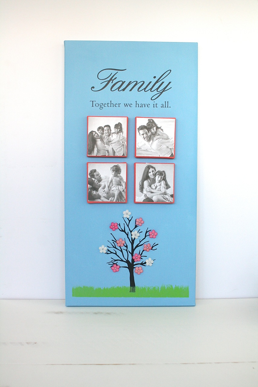 "Family Art: Celebrate your loved ones with this simple Family Art. Grab a long canvas (this one measures 10"" x 20""), four 3"" x 3"" square canvases, blue, green and coral acrylic paint, 3-D flower stickers, vinyl words ""Family Together We Have it All,"" vinyl tree (all vinyl from Decorating Your Life) and craft glue. Don't forget to have four cute family photos (measuring 3"" x 3"") and doubled sided tape on hand as well.  Start by painting the canvas blue and the four small square canvases coral. When the paint is dry, add the vinyl words and tree to the canvas. Then use the green acrylic paint to make grass at the base of the tree. Next, use doubled sided tape to attach the family photos to the square canvases. Adhere them to the larger canvas with craft glue. Finish by placing the 3-D flower stickers on the tree. (Image: Malia Karlinsky / Seattle Refined)"