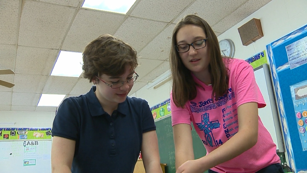 Seventh grade classmates Emerson Dycus and Sarah McAllister have three experiments heading into space on a NASA rocket in June 2015.