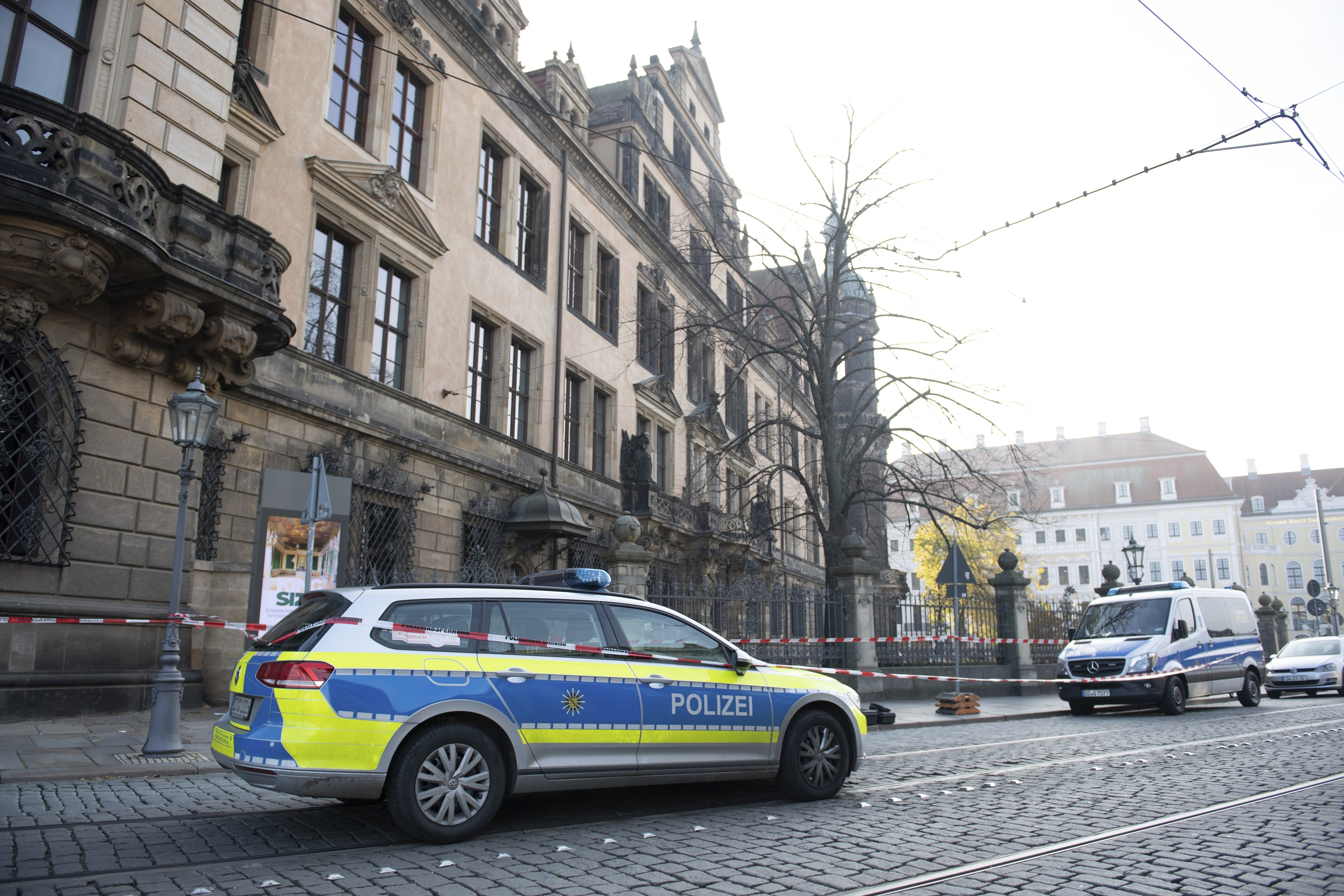 Police cars stand in front of the Residenzschloss, Residence Palace, building in Dresden Monday, Nov. 25, 2019. (Sebastian Kahnert/dpa via AP)