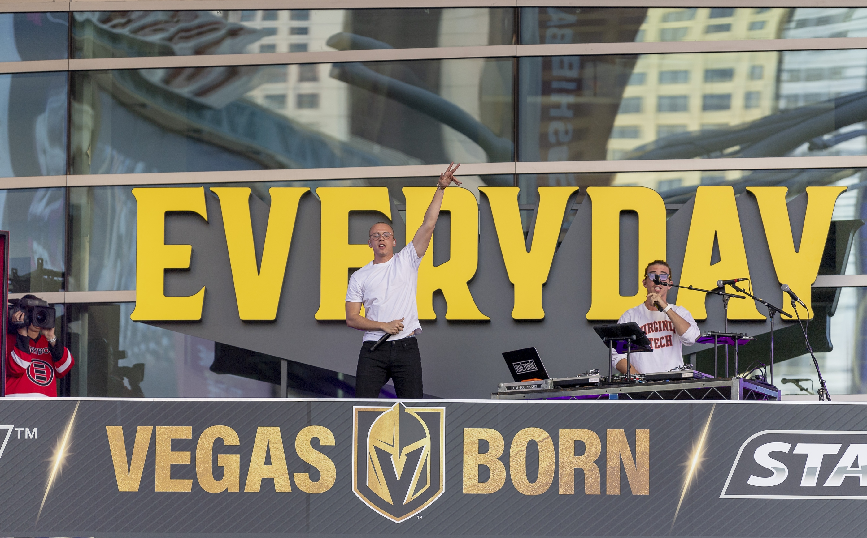 Rapper Logic, left, along with his DJ Rhetoric perform for the crowd in the pre-game celebration at Toshiba Plaza as the Vegas Golden Knights prepare to meet the Los Angeles Kings in the first quarterfinal game of the NHL Stanley Cup Playoffs at T-Mobile Arena in Las Vegas on Wednesday, April 11, 2018.  CREDIT: Mark Damon/Las Vegas News Bureau