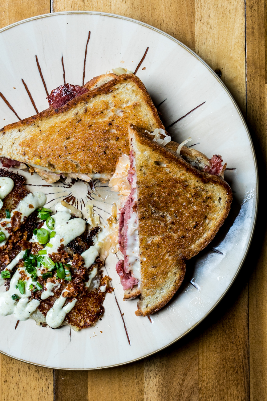 Reuben: house corned beef, sauerkraut, Thousand Island dressing, and Swiss cheese on thick marbled rye with boxty (an Irish potato pancake) / Image: Amy Elisabeth Spasoff // Published: 4.29.19
