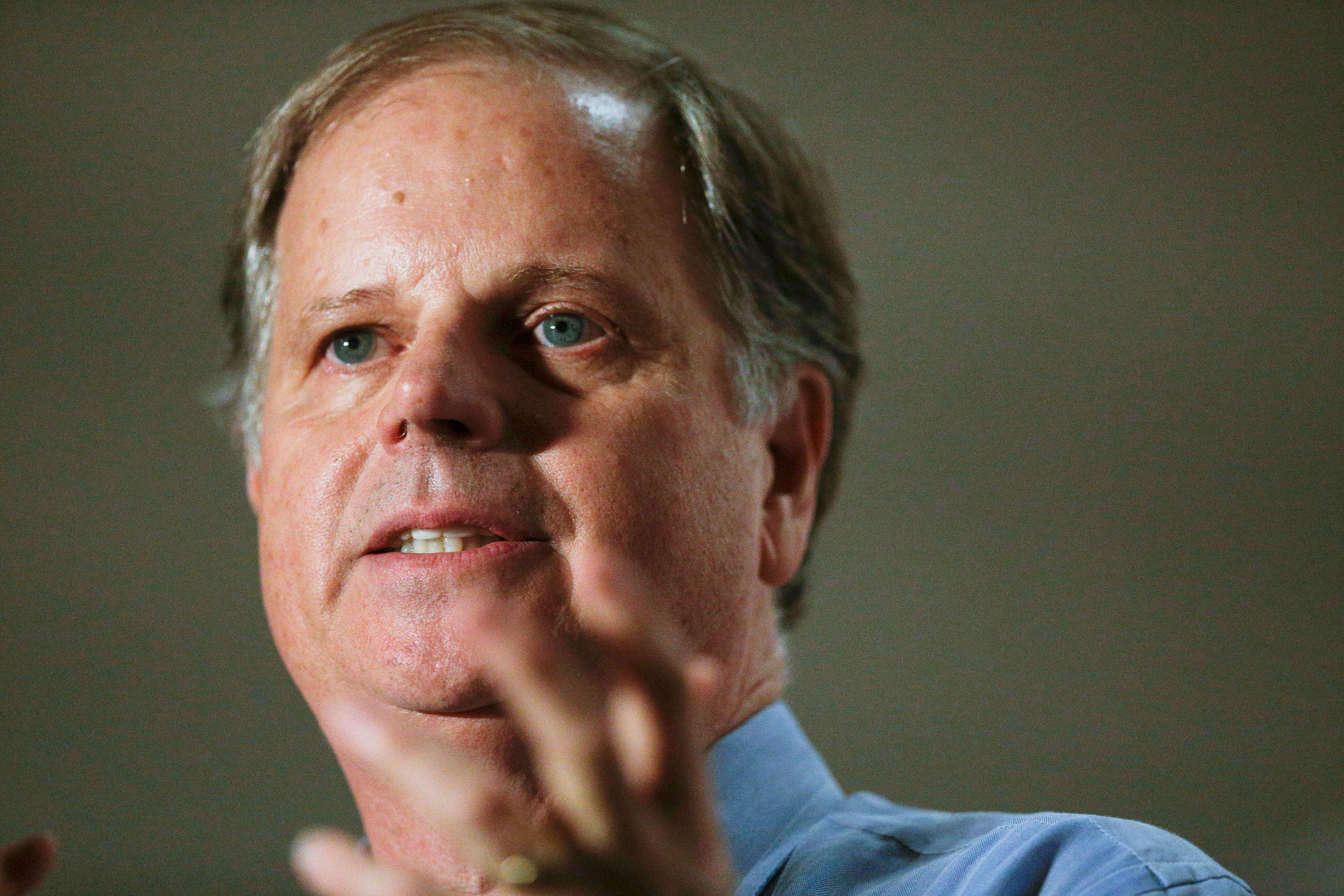 FILE - In this Tuesday, Oct. 3, 2017, file photo, Democrat Doug Jones speaks at a campaign rally for the race to fill Attorney General Jeff Sessions' former Senate seat, in Birmingham, Ala. President Donald Trump in tweets Sunday, Nov. 26, is again coming to the side of Republican Roy Moore by bashing Jones in the Alabama Senate race. (AP Photo/Brynn Anderson, File)