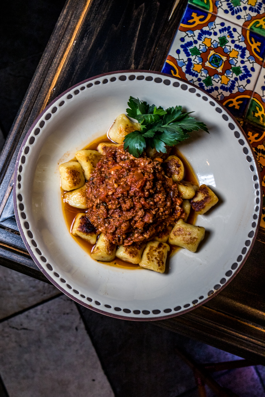 Gnocchi Bolognese: braised beef and veal sauce, marinara, and parmesan{ }/ Image: Catherine Viox{ }// Published: 4.21.20
