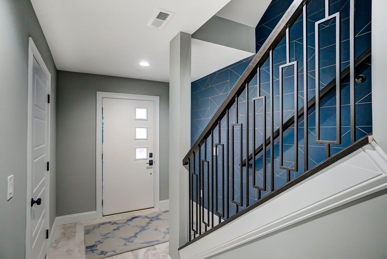 The front door to 136 Dorsey leads straight upstairs to the living room and kitchen areas. / Image courtesy of Kelly Gibbs, Coldwell Banker // Published: 12.28.18