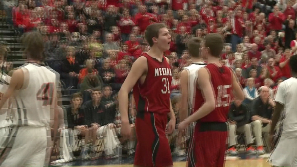 Neenah's Matt Heldt (31) celebrated after making a basket during the team's sectional final game on Saturday, March 8, 2014.