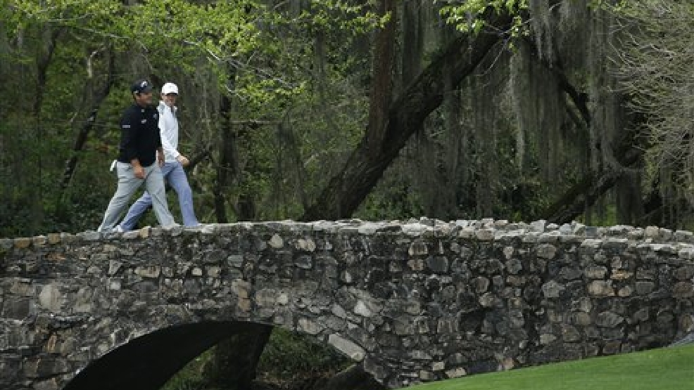 Patrick Reed, left, walks across the Byron Nelson Bridge with Rory McIlroy, of Northern Ireland, during a practice round for the Masters golf tournament Tuesday, April 8, 2014, in Augusta, Ga. (AP Photo/Matt Slocum)