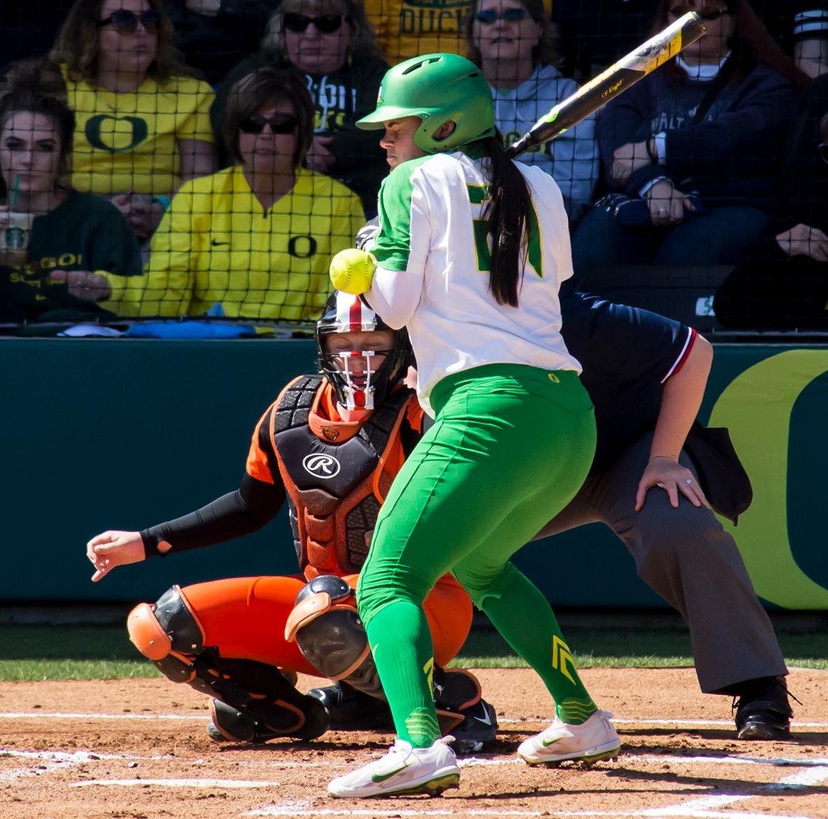 Oregon catcher Gwen Svekis (#21) is hit with a pitch thrown by Oregon State Pitcher Taylor Cotton (#7). The Oregon Ducks defeated the Oregon State Beavers seven to zero on Sunday, April 30, 2017. The Ducks' victory marked the third victory of the three game sweep against the Beavers. Photo by Ben Lonergan, Oregon News Lab