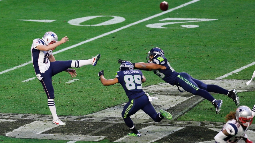 Ryan Allen of the New England Patriots punts under pressure against the Seattle Seahawks at the University of Phoenix Stadium on Feb. 1, 2015 in Glendale, Arizona. The Patriots defeated the Seahawks, 28-24, to win Super Bowl XLIX. (Photo by Michael Zagaris/Getty Images)