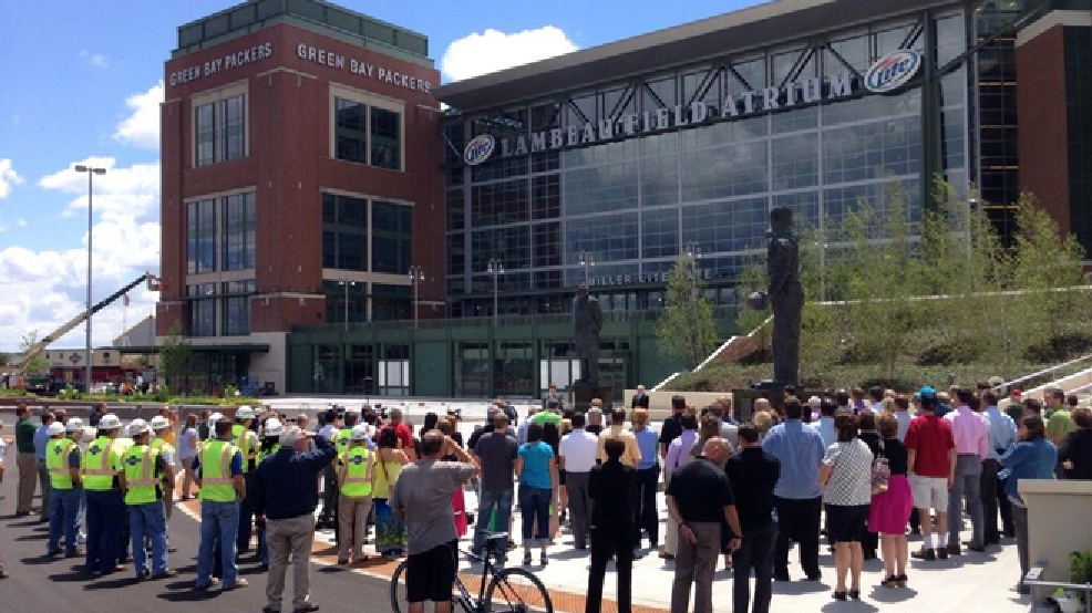 The Green Bay Packers hold a rededication ceremony for Harlan Plaza outside Lambeau Field, July 9, 2014. (WLUK/Andrew LaCombe)