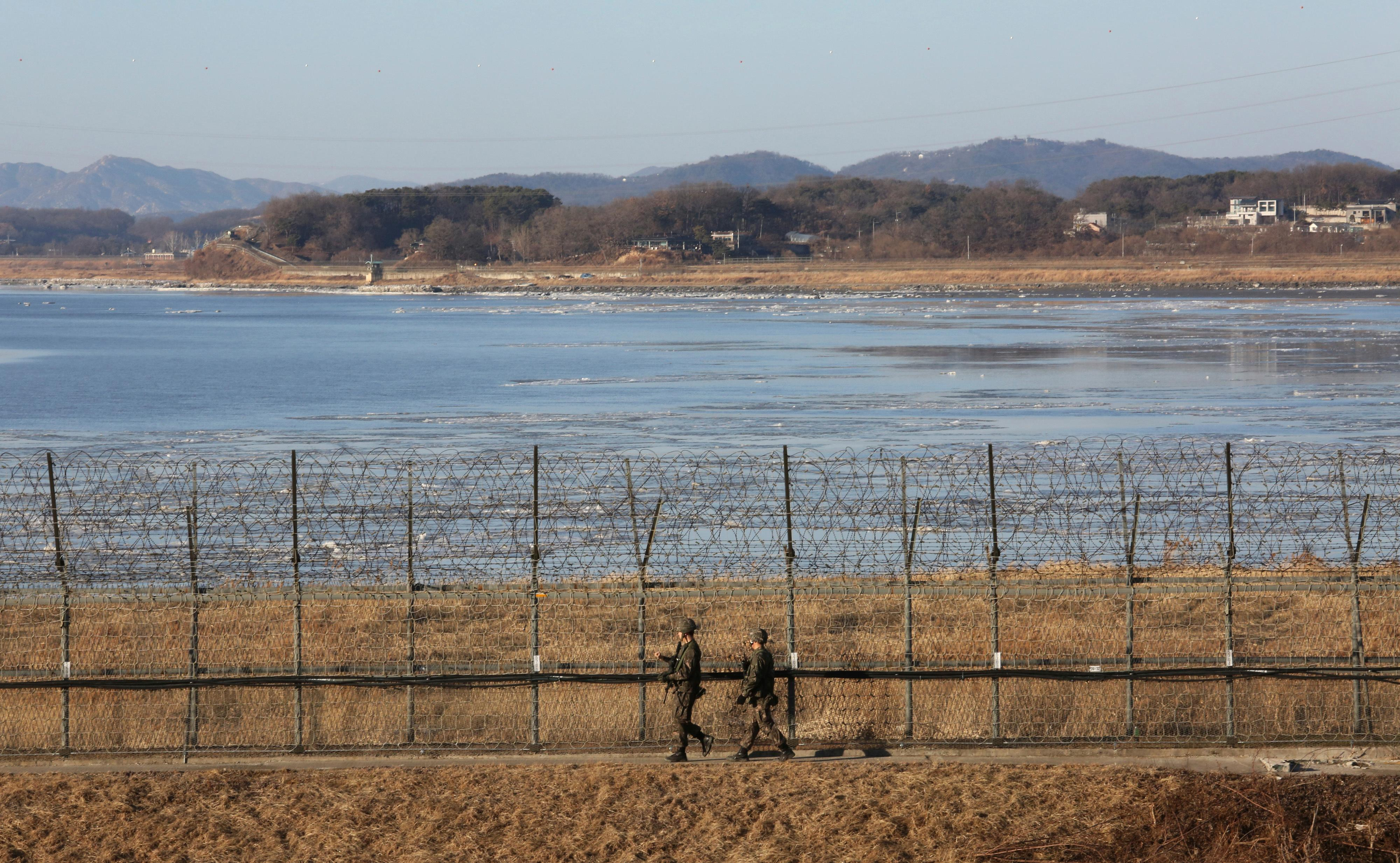 "South Korean army soldiers patrol along the barbed-wire fence in Paju, South Korea, near the border with North Korea Monday, Dec. 25, 2017. North Korea on Sunday called the latest U.N. sanctions to target the country ""an act of war"" that violates its sovereignty, and said it is a ""pipe dream"" for the United States to think it will give up its nuclear weapons. (AP Photo/Ahn Young-joon)"