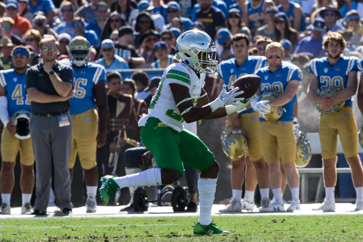 Oregon wide receiver Jaylon Redd (#30) bobbles a pass before securing it. The Oregon Ducks rallied during the second quarter to go into halftime tied 14-14 with the UCLA Bruins at Rose Bowl Stadium in Pasadena, California. Photo by Austin Hicks, Oregon News Lab