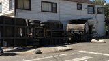 2 injured as truck slams into Orting building