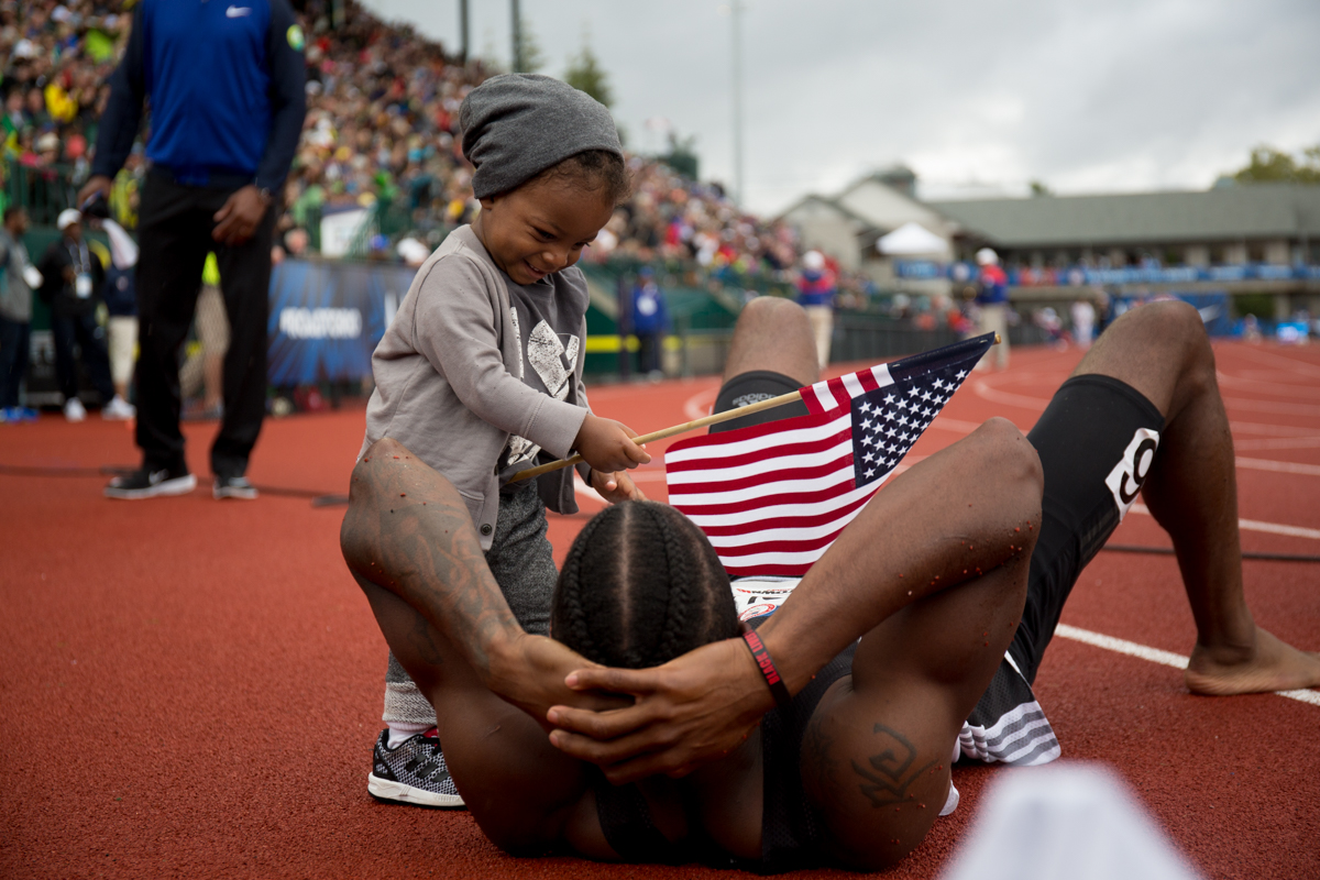 Michael Tinsley celebrates with his son Titus Maximus after placing third in the 400m hurdles. Day Ten of the U.S. Olympic Trials Track and Field concluded on Sunday at Hayward Field in Eugene, Ore. Competition lasted July 1 - July 10. Photo by Dillon Vibes