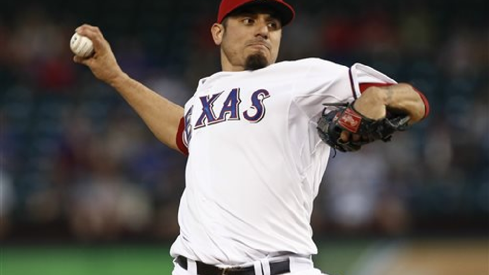 Texas Rangers starting pitcher Matt Garza (22) delivers a pitch to the Los Angeles Angels during the first inning of a baseball game, Thursday, Sept. 26, 2013, in Arlington, Texas. (AP Photo/Jim Cowsert)