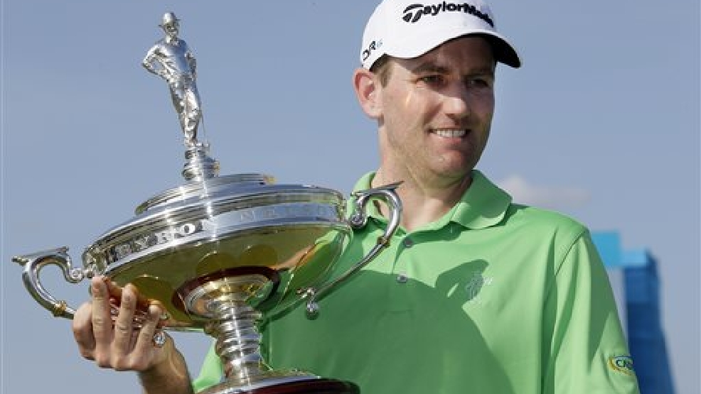 Brendon Todd poses with the trophy after winning the Byron Nelson Championship golf tournament, Sunday, May 18, 2014, in Irving, Texas. (AP Photo/Tony Gutierrez)
