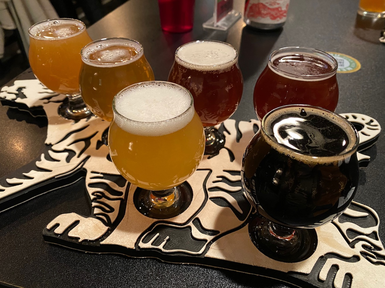 Pictured is a flight at Three Tigers Brewing, ranging from their Small Ax pale ale to the delicious Skeleton Key stout. They serve an array of Vietnamese and Vietnamese-inspired food, as owner Scott Wilkins lived in the country for some time. It's just one of several breweries in Licking County, which offers a beverage trail guide of local breweries, wineries, and coffee and soda shops. ADDRESS: 140 N Prospect Street, Granville, OH (43023) / Image: Chez Chesak{ }// Published: 2.12.21