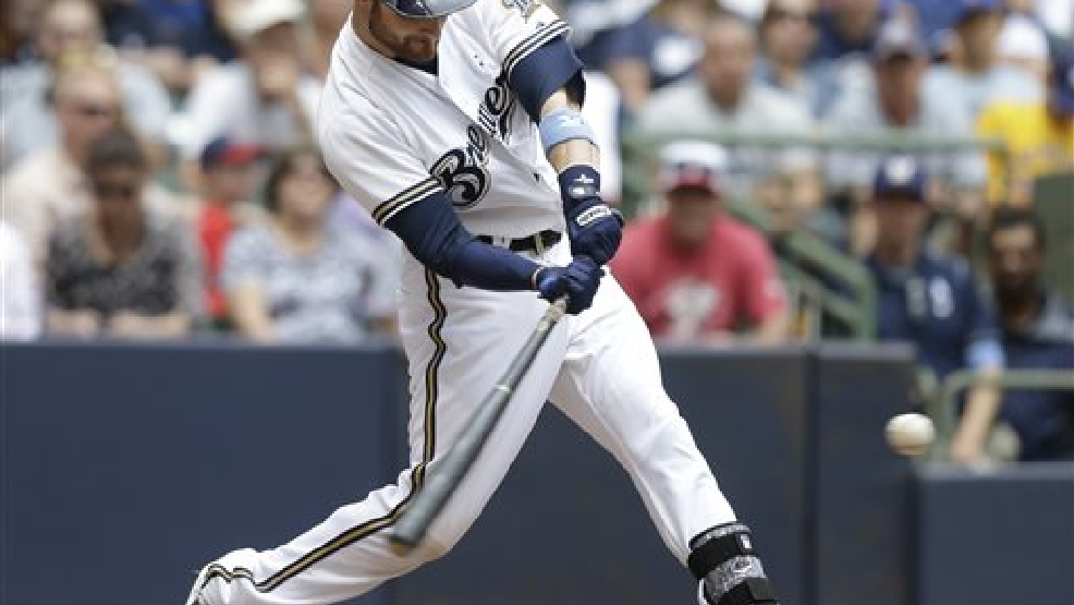 Milwaukee Brewers' Jonathan Lucroy hits a home run against the Cincinnati Reds during the fifth inning of a baseball game Sunday, June 15, 2014, in Milwaukee. (AP Photo/Jeffrey Phelps)
