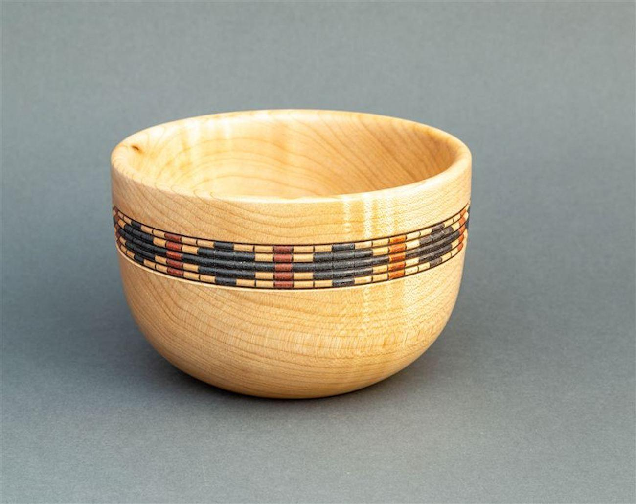 Six-inch maple bowl by Beverly Connelly / Beads were turned in the side, lines burned, and Indian ink was used to create the design. / Image courtesy of the Ohio Valley Woodturners Guild // Published: 4.18.19