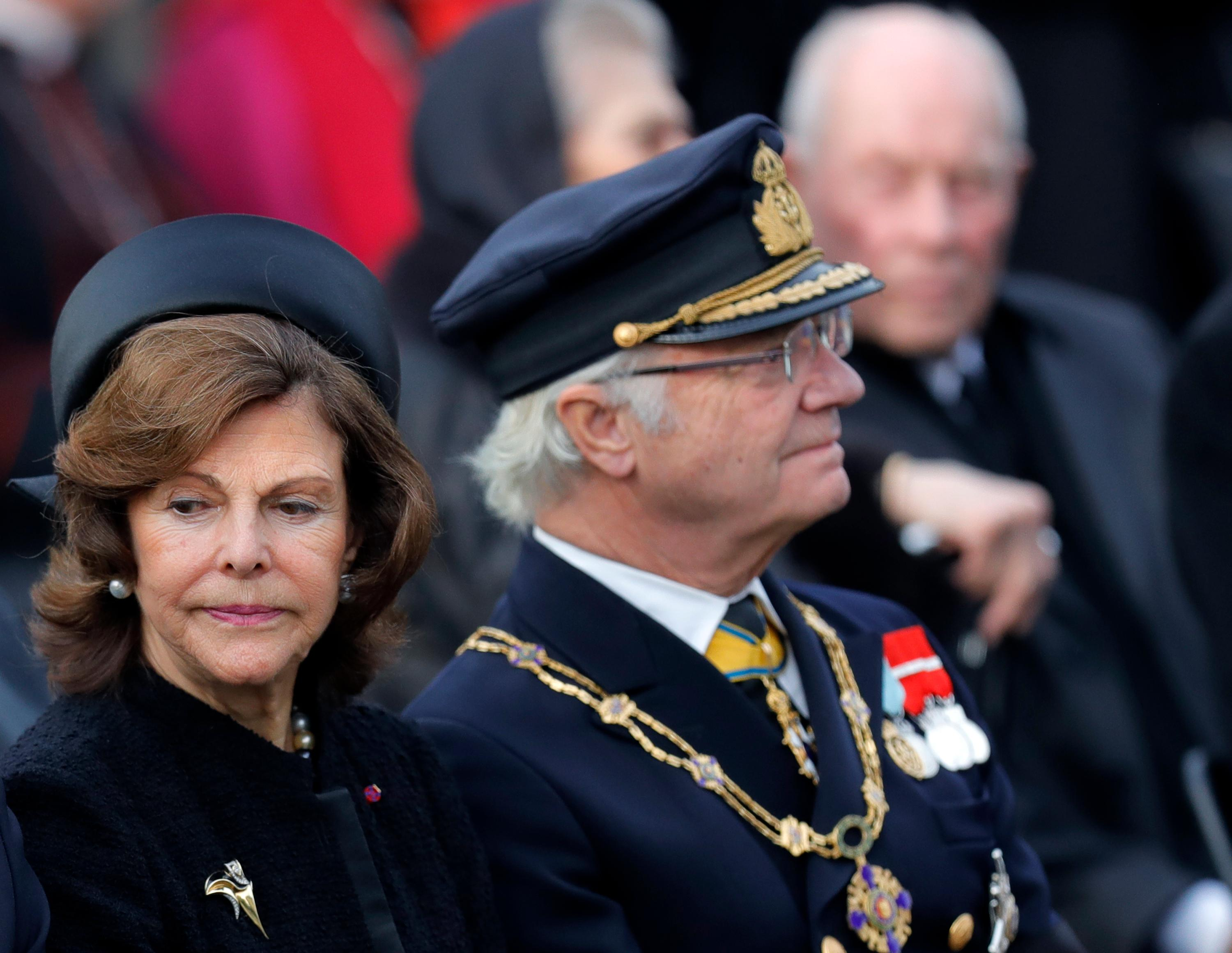 Sweden's King Carl XVI Gustaf, right, and Queen Silvia attend the funeral ceremony in tribute to late Romanian King Michael in Bucharest, Romania, Saturday, Dec.16, 2017. Thousands waited in line to pay their respects to Former King Michael, who ruled Romania during WWII, and died on Dec. 5, 2017, aged 96, in Switzerland. (AP Photo/Vadim Ghirda)