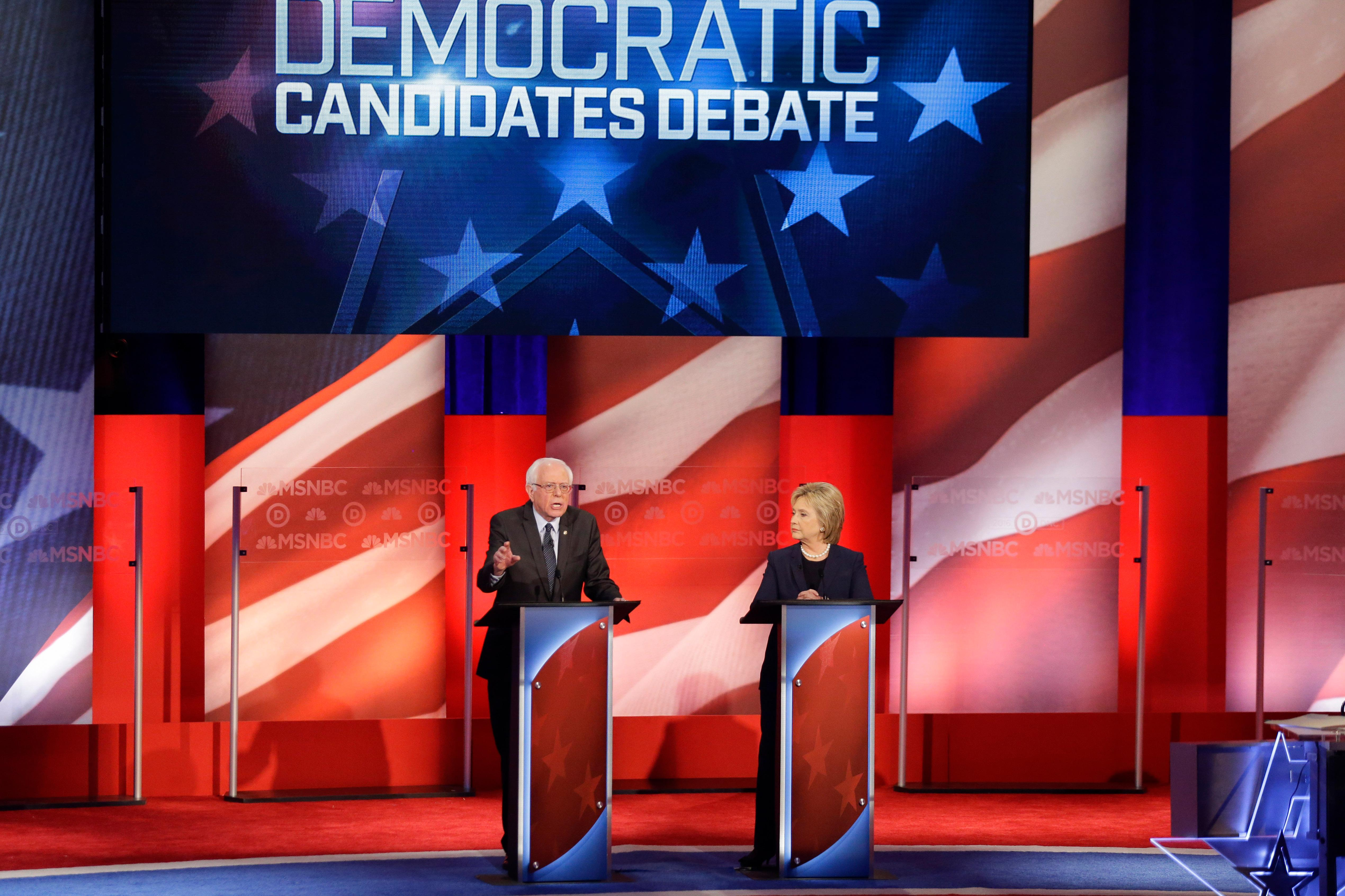 Democratic presidential candidate, Sen. Bernie Sanders, I-Vt,  makes his opening statement as Democratic presidential candidate, Hillary Clinton  listens during a Democratic presidential primary debate hosted by MSNBC at the University of New Hampshire Thursday, Feb. 4, 2016, in Durham, N.H. (AP Photo/David Goldman)