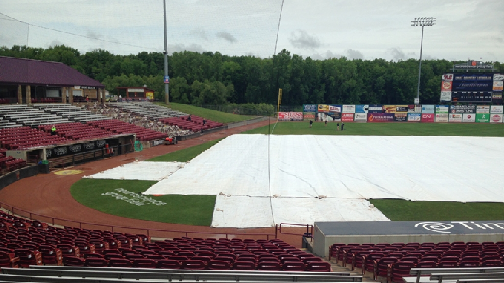 A tarp covers the infield of Fox Cities Stadium in Grand Chute as the WIAA state high school baseball tournament is in a rain delay, June 18, 2014. (WLUK/Laura Smith)