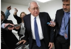 Senate Armed Services Committee Chairman Sen. Carl Levin, D-Mich. is pursued by reporters on Capitol Hill in Washington, Tuesday, June 10, 2014, as senators received a briefing with national security officials about the decision to swap captive Army Sgt. Bowe Bergdahl for five detainees at Guantanamo Bay. (AP Photo/J. Scott Applewhite)