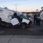 Person rescued after van crashes into flatbed trailer