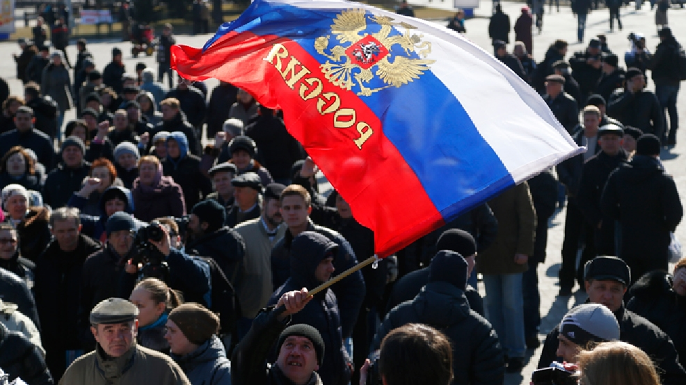 A man waves a Russian flag during a pro Russian rally at a central square in Donetsk, eastern Ukraine, Monday, March 10, 2014. (AP Photo/Sergei Grits)