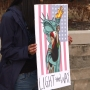 Locals hold President's Day vigil to welcome immigrants, refugees