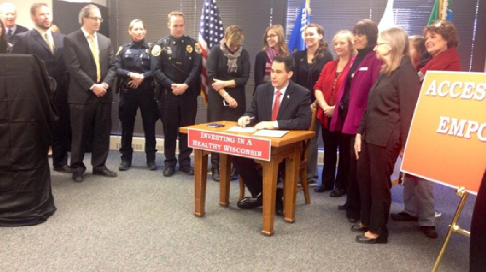 Gov. Scott Walker signs seven bills into law that are designed to improve mental health services in the state, Thursday, Feb. 6, 2014. (WLUK/Bill Miston)