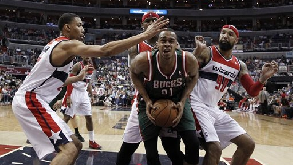 Washington Wizards forwards Otto Porter Jr. (22), Al Harrington and Drew Gooden (90)