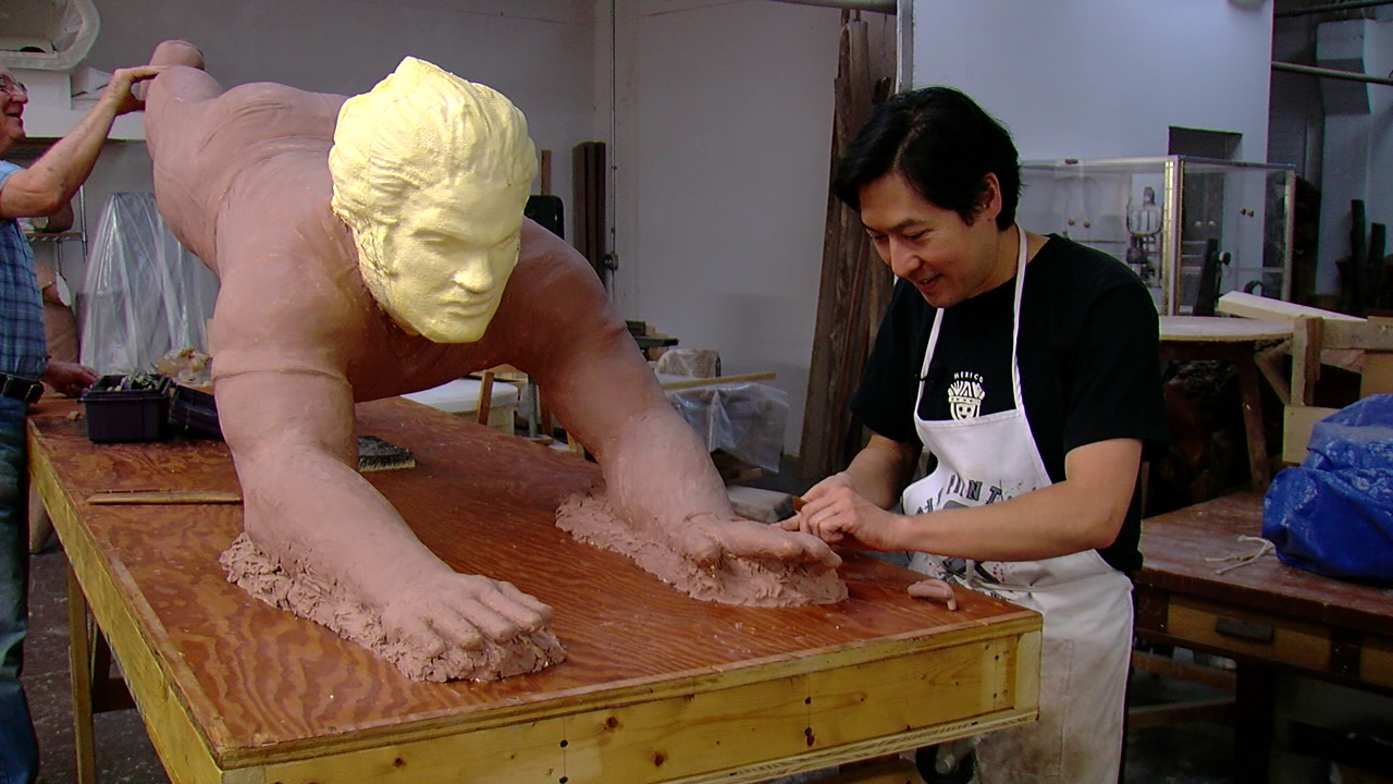 Sculptor Tom Tsuchiya and his assistant Ray Miller finish the clay-covered foam model of the Pete Rose statue on April 4, 2017. (WKRC)