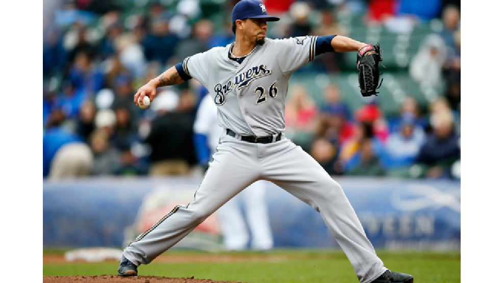 Milwaukee Brewers starting pitcher Kyle Lohse delivers against the Chicago Cubs during the first inning of a baseball game on Friday, May 16, 2014, in Chicago. (AP Photo/Andrew A. Nelles)