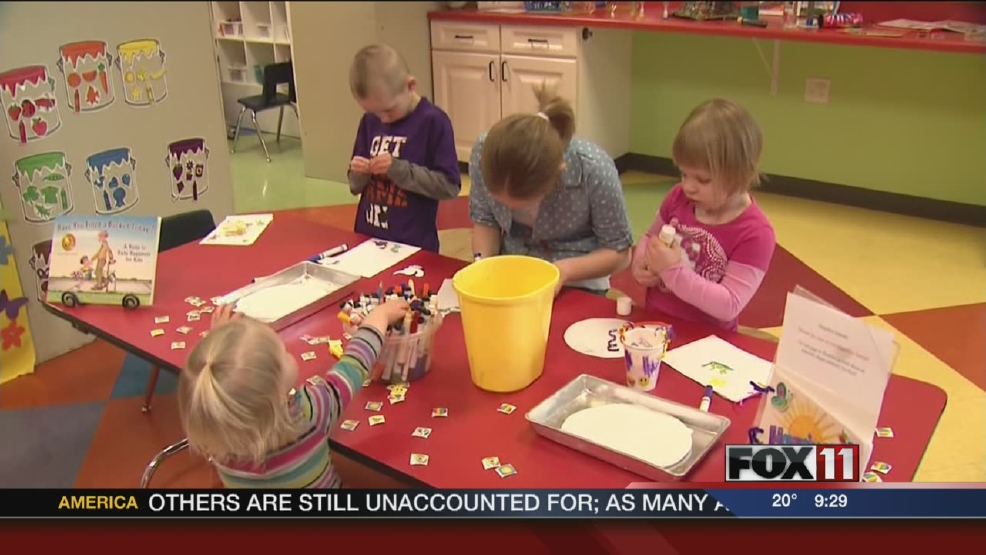 Children take part in crafts and activities for Happiness Week at the Building for Kids in Appleton.