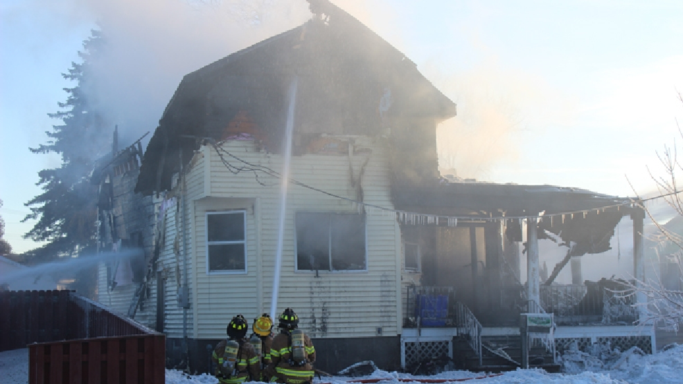 Firefighters battle a house fire in Two Rivers, Tuesday, Feb. 11, 2014. (ReportIt/Brian Adams)