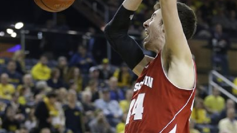 Wisconsin forward Frank Kaminsky (44) dunks during the second half of an NCAA college basketball game against Michigan in Ann Arbor, Mich., Sunday, Feb. 16, 2014. Kaminsky finished with 25 points in the Badgers 75-62 win. (AP Photo/Carlos Osorio)