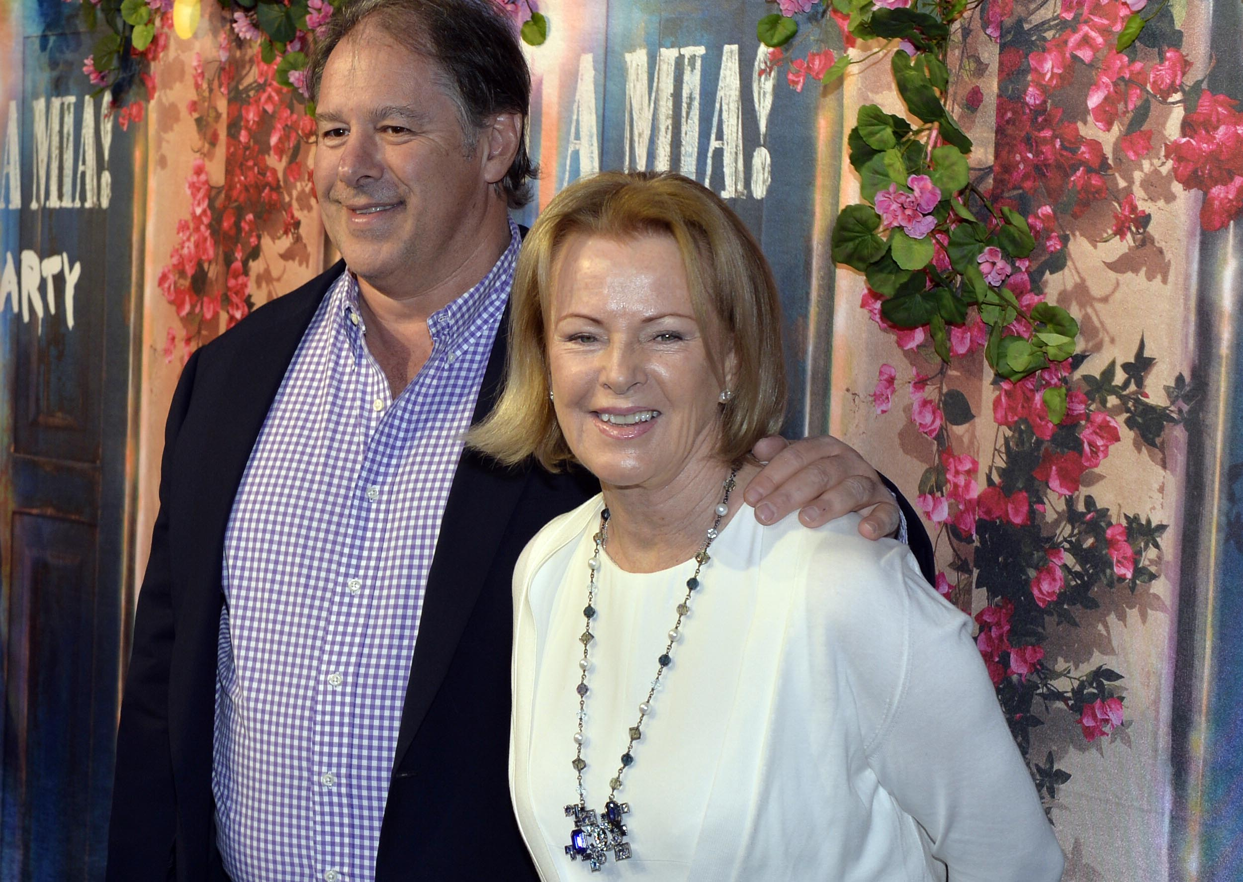 "Former Abba member Anni-Frid Lyngstad and partner Henry Smith arrive for the premiere of ""Mamma Mia The Party ""  at the Tyrol restaurant, in Stockholm,  Sweden, Wednesday, Jan. 20, 2016. The four former members of iconic Swedish pop group ABBA have made a rare joint appearance for the opening of a Stockholm restaurant inspired by the ""Mamma Mia!"" musical. (Anders Wiklund /TT via AP)"