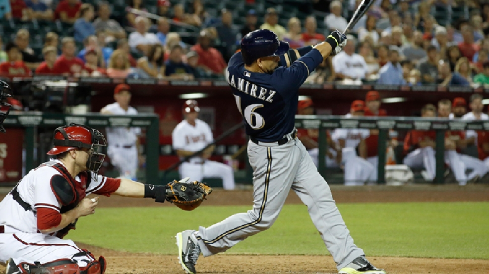 Milwaukee Brewers' Aramis Ramirez, right, connects for a two-run double as Arizona Diamondbacks' Miguel Montero, left, looks on during the eighth inning of a baseball game on Monday, June 16, 2014, in Phoenix. (AP Photo/Ross D. Franklin)