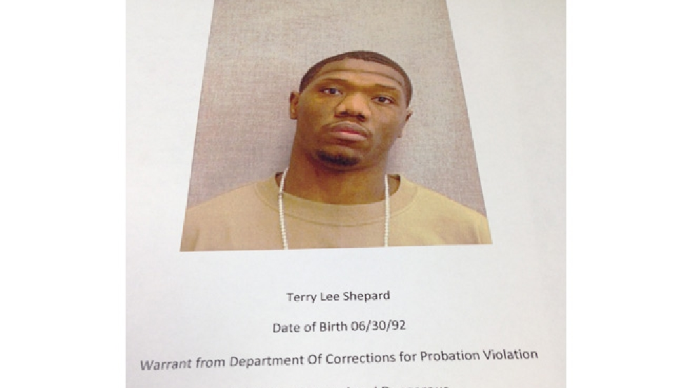 Photo of a poster provided by Green Bay police identifying Terry Lee Shepard as a person of interest in the April 15, 2014 shooting death of Steven Sims. (WLUK/Laura Smith)