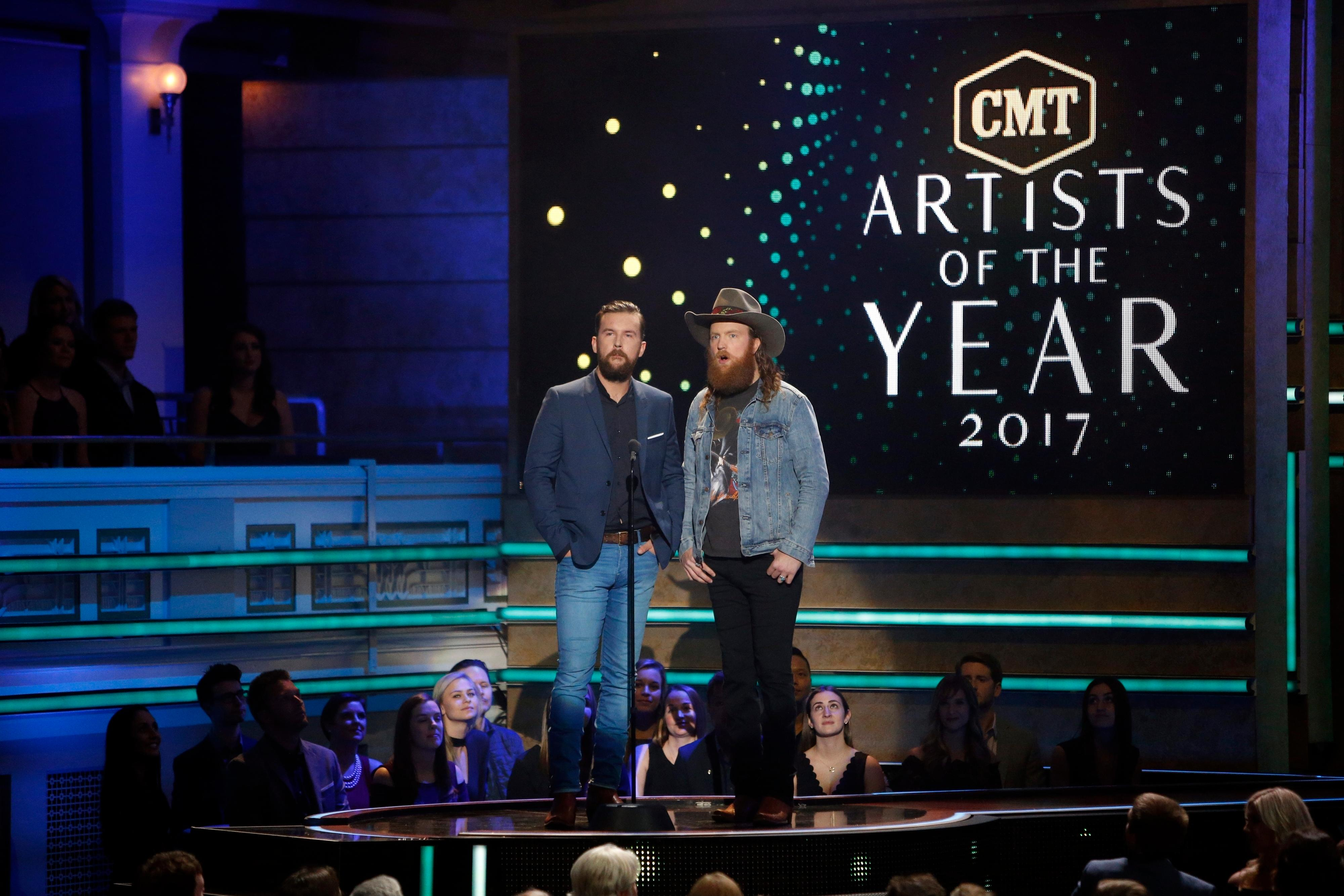 Brothers Osborne, John Osborne T.J. Osborne are seen at 2017 CMT Artist of the Year Awards at Nashville's Schermerhorn Symphony Center on Wednesday, Oct. 18, 2017, in Nashville, Tenn. (Photo by Wade Payne/Invision/AP)