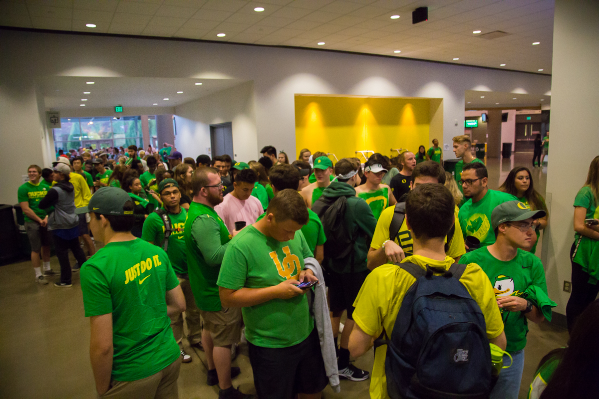Oregon students line up out the door over an hour before the start of the Oregon volleyball game versus Stanford. The Oregon volleyball team fell to the the Stanford Cardinal, the defending national champions, in three straight sets Friday night. There were 5,872 people in attendance, the second most at an Oregon volleyball game ever. Photo by Dillon Vibes
