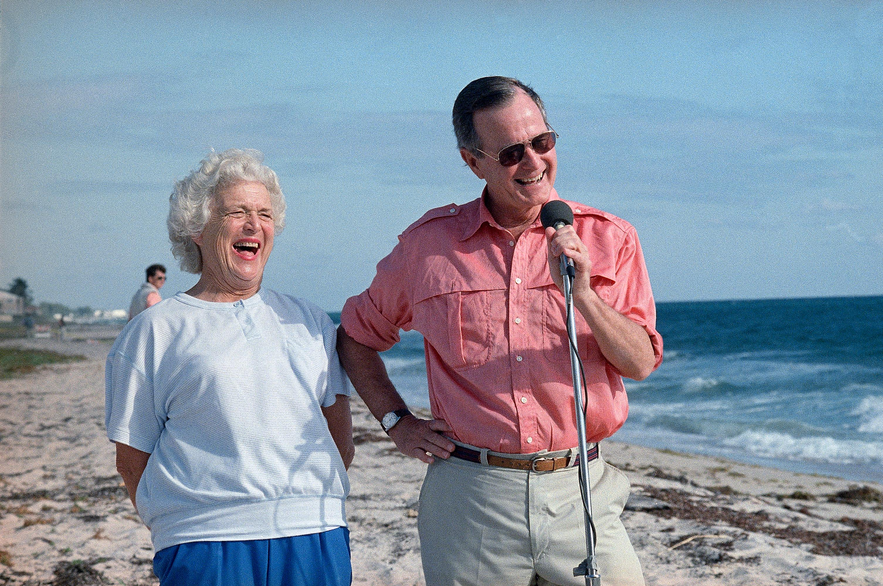 FILE - In this Nov. 14, 1988, file photo, President-elect George H.W. Bush and his wife, Barbara, are shown during a morning beachfront news conference in Gulf Stream, Fla. A family spokesman said Tuesday, April 17, 2018, that former first lady Barbara Bush has died at the age of 92. (AP Photo/Kathy Willens, File)