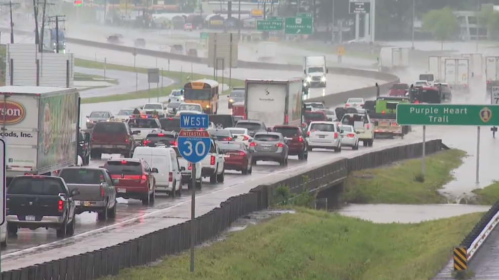 Flooding closes roads, snarls traffic across central