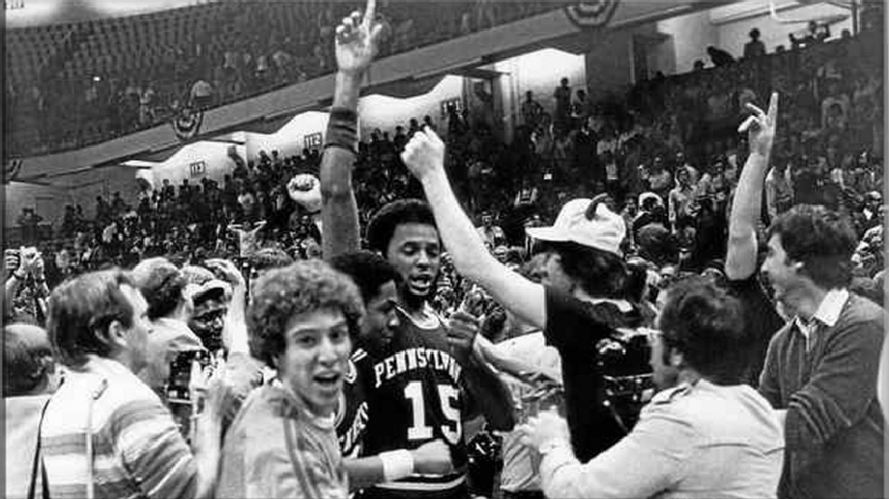 Penn's Tony Price is mobbed leaving the court in Greensboro, N.C., after the Quakers beat St. John's, 64-62, in the NCAA Tournament's East Regional final on March 18, 1979. The victory sent the Quakers to the Final Four in Salt Lake City. (Courtesy University of Pennsylvania Archives)