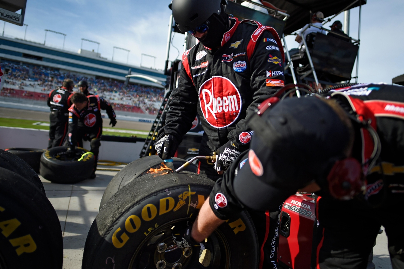 Austin Dillion's crew members scrape debris off a tire before measuring its wear during the NASCAR Xfinity Series Boyd Gaming 300 Saturday, March 11, 2017, at the Las Vegas Motor Speedway. (Sam Morris/Las Vegas News Bureau)