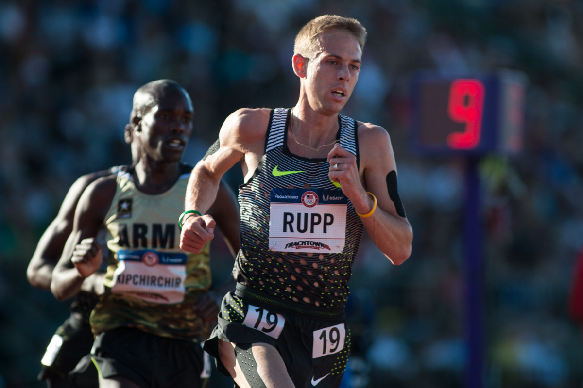 Nike�s Galen Rupp leads Shadrack Kipchirchir with 9 laps to go in the men�s 10,000m. Rupp would eventually win the race in a time of 27:55. Photo by Dillon Vibes